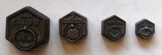 Vier Alte Eisengewichte Bild