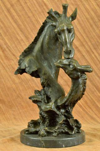 Art Deco Giraffenmutter Mit Baby Bronzefigur Bild