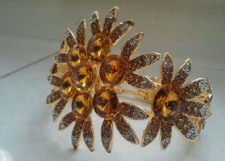 Klapp Arm Reifen Goldfarbene Blüte Kristall Schmuck Viel Strass Gold Bild