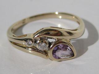 Feiner Diamantring 585 Gelbgold,  14 Kt Gold Goldring,  2 Diamanten 1 Lila Stein Bild