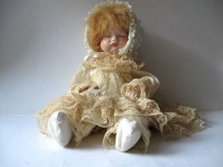 Süße Puppe - Repro - Porzellankopf - Brustkopf Puppe - Stoffkörper - Länge:36cm Bild