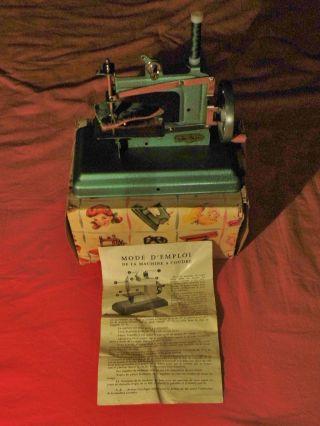 Kindernähmaschine Ca.  1960,  Blechspielzeug,  Nähmaschine Rose Marie,  Mit Karton Bild