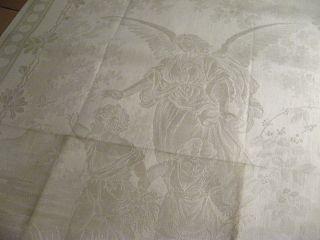 Unbenutztes Leinen Handtuch Mit Engel Schützend über Kindern Bild