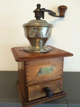 Alte/antike Manuelle Kaffeemühle Armin Trösser.  Coffee Grinder. Bild