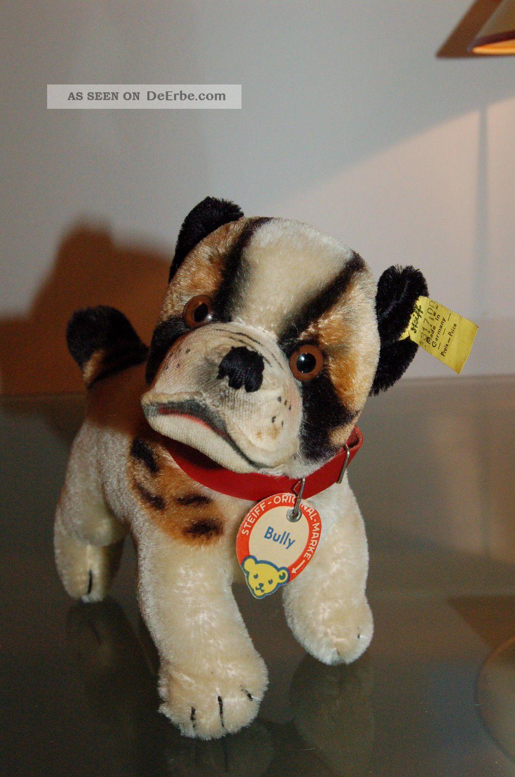 Steiff-Kuscheltiere & -Puppen Süße getigerte Katze von Steiff mit Knopf und Fahne