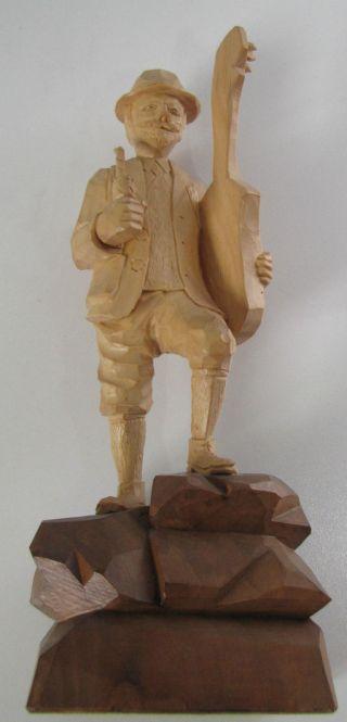 Holzfigur Des Liedermachers Anton Günther Bild