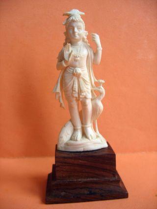 Fein Geschnitzte Indische Gottheit,  Bein Auf Holzsockel Bild