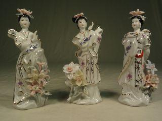 Drei Porzellan Geishas,  China Bild