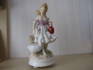 Spieluhr - Porzellanfigur - Gänseliesel Bild