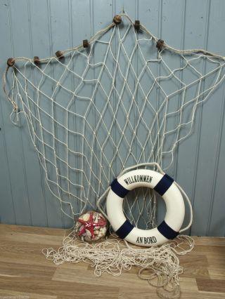 Fischernetz 1,  2x2,  5m Natur 7 Schwimmer,  36cm Rettungsring B/w,  Muschelkorb Bild