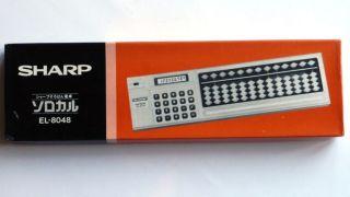 Sharp El - 8048 – In Ovp Ungeöffnet – Soroban Mit Taschenrechner Bild