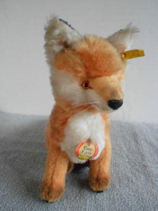 Steiff Fuchs Cosy Fuzzy,  22 Cm Sitzend,  Mit Knopf,  Fahne,  Brustschild Bild