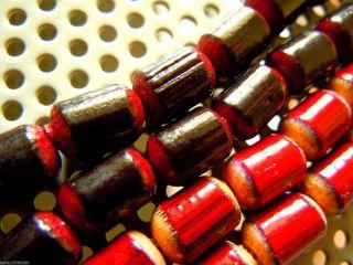 Peruanische Cranberry&black Barrel Bambusholz - Perlen - Strang Ca.  22cm Lang - 7x10mm Bild