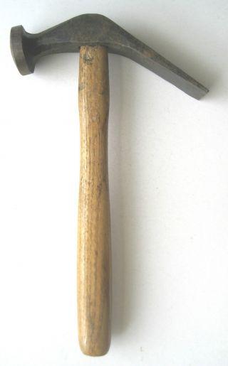 Altes Werkzeug / Alter Schusterhammer Bild