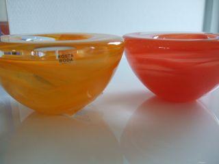 2 Atoll Teelichthalter,  2 Orangetöne,  Kosta Boda Anna Ehrner Schweden Bild