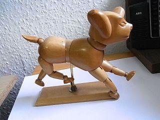 Hund Holz Figur Scharnier Bewegung Bild