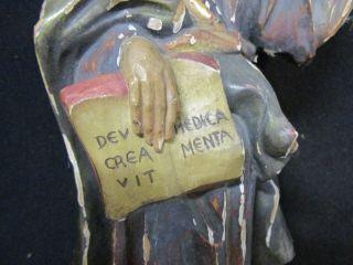 Geschnitzte Lindenholzfigur Aus Einer Apotheke Mit Lateinischem Sinnspruch Bild