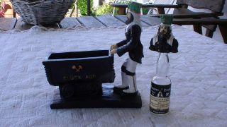 Bergmann Mit Lore (kohlenwagen) Und Flaschenverschluss Bild