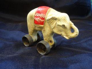Antikspielzeug Elefant Figur Auf Rädern Jumbo Spardose Aus Gußeisen Bild