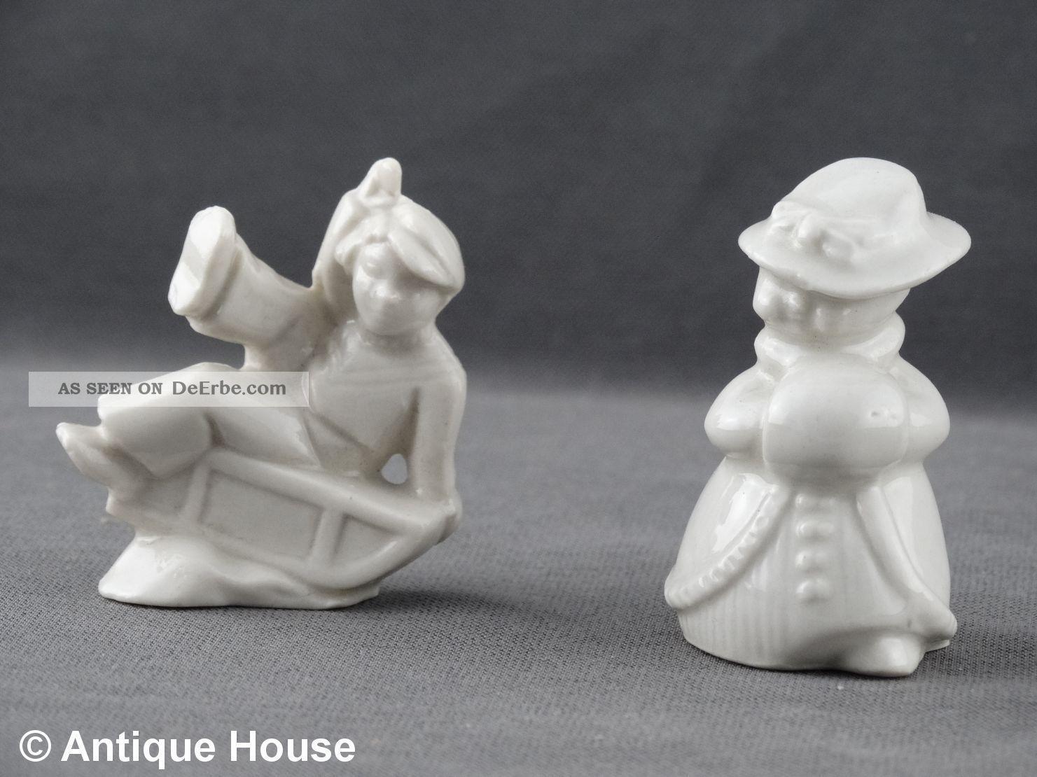 2 Kleine Porzellanfiguren Weiß Unbemalt Schlittenfahrer Und Dame Mit Muff Nach Form & Funktion Bild