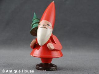 Wendt & Kühn Alter Weihnachtsmann Wichtel Mit Tannenbaum Ovales Logo Bild