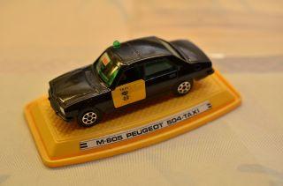 Sammlerstück Modellauto Pilen S.  A.  M - 805 Peugeot 504 Taxi Bild