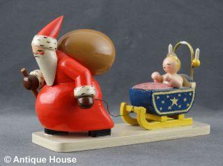 Wendt & Kühn Alter Weihnachtsmann Mit Christkind Und Schlitten Ovales Logo Ab 19 Bild